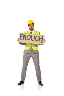 Engineer in suit and hardhat holding signboard with enough lettering and looking at camera on white background stock vector