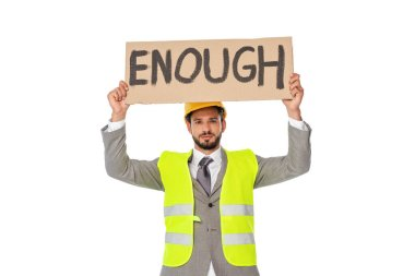 Engineer in suit and safety vest holding signboard with enough lettering isolated on white stock vector