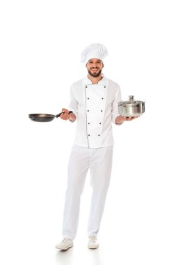 Handsome smiling chef holding frying pan and pan on white background stock vector