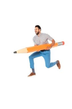 Smiling nerd holding huge pencil while jumping isolated on white stock vector