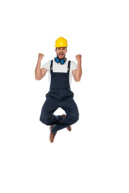 Excited builder in uniform showing yeah gesture isolated on white