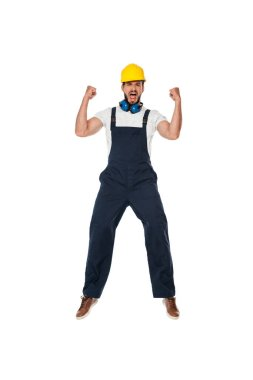 Excited builder in workwear and hardhat showing yes gesture isolated on white stock vector