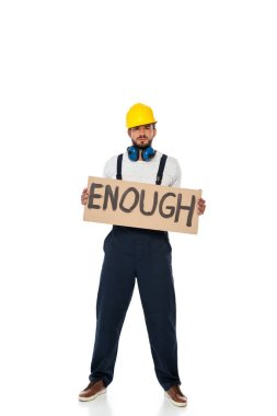 Handsome builder in uniform holding signboard with enough lettering on white background stock vector