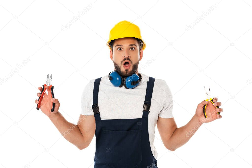 Shocked workman holding pliers and looking at camera isolated on white stock vector