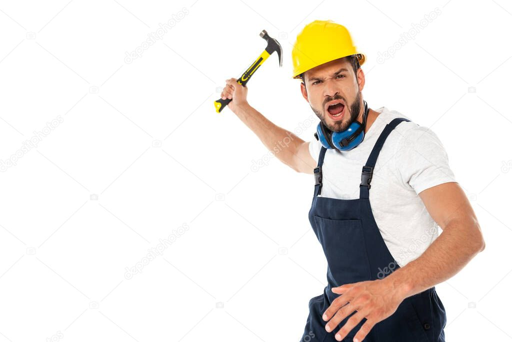 Angry workman in uniform and hardhat screaming while holding hammer isolated on white stock vector