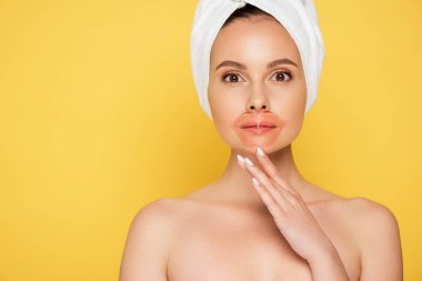 Naked beautiful woman with towel on head, lip patch isolated on yellow stock vector