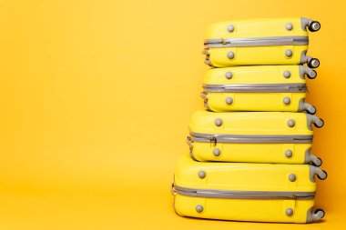 Stack of travel bags on yellow background stock vector
