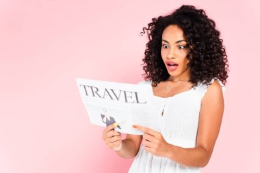 Surprised african american girl reading travel newspaper isolated on pink stock vector