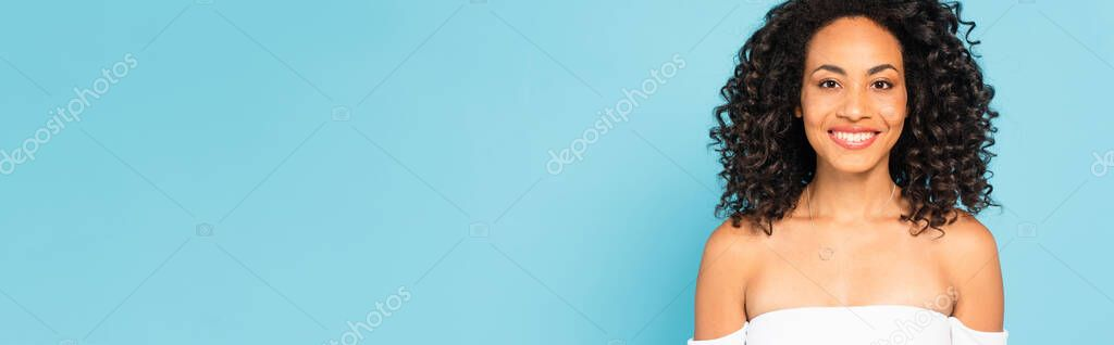 Panoramic concept of happy african american girl isolated on blue stock vector