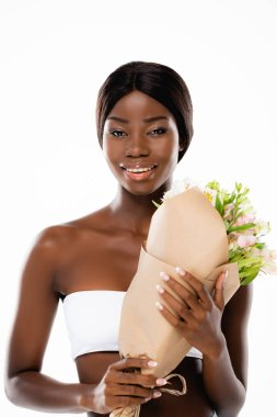 African american woman smiling while holding bouquet of flowers isolated on white stock vector
