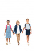 curly schoolboy holding hands with multicultural schoolgirls and walking isolated on white
