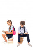 schoolkids sitting on books and reading isolated on white