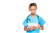 child in costume of doctor using digital tablet isolated on white