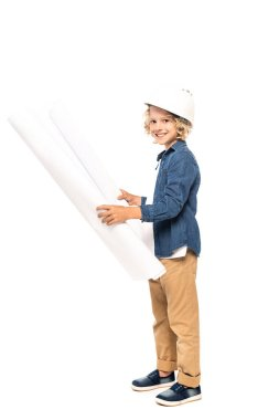 Curly boy in safety helmet and costume of architect holding blueprint and looking at camera isolated on white stock vector