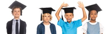 Panoramic crop of multicultural kids in graduation caps dressed in costumes of different professions near child with raised hands isolated on white stock vector