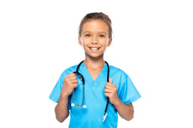 Child in costume of doctor touching stethoscope and looking at camera isolated on white stock vector