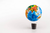 globe on plastic cup with ground on white background