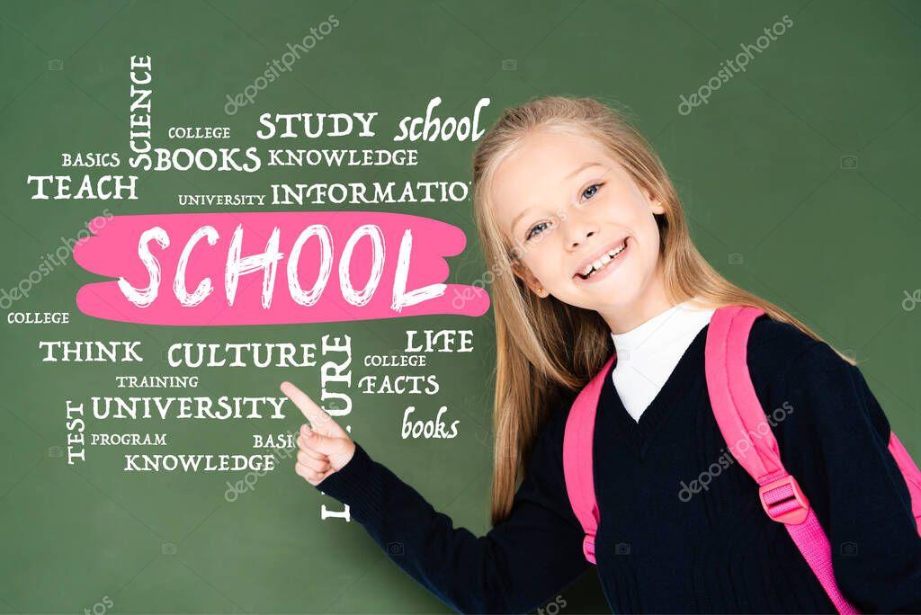 Schoolgirl pointing with finger at school illustration on green chalkboard stock vector