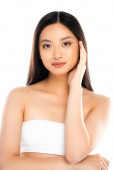Photo Asian woman looking at camera and touching face isolated on white