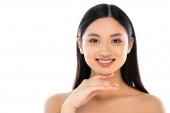 Photo Excited young asian woman looking at camera and touching face isolated on white
