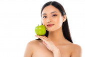 Photo Young asian woman looking at camera and holding apple isolated on white
