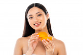 Photo nude asian woman looking at camera while holding cut orange isolated on white