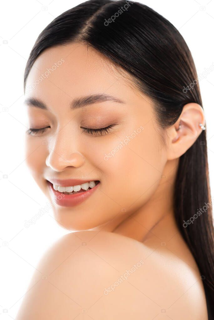 Portrait of young excited asian woman with closed eyes isolated on white stock vector