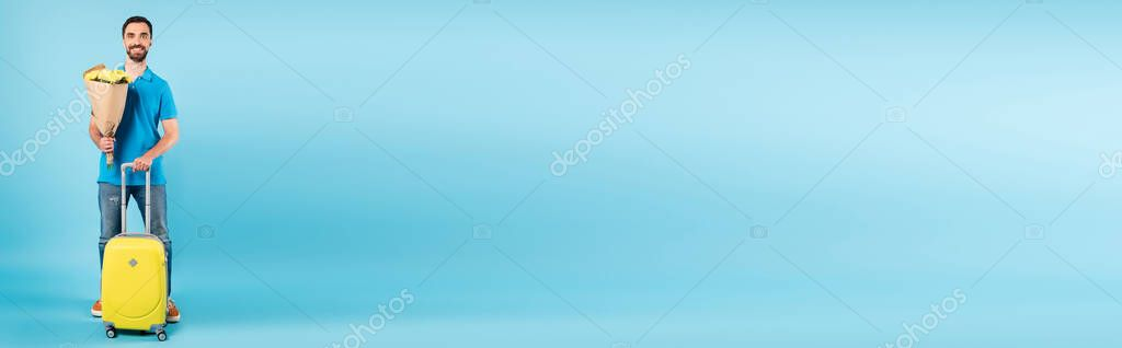 Horizontal concept of tourist standing with yellow suitcase and holding bouquet on blue stock vector