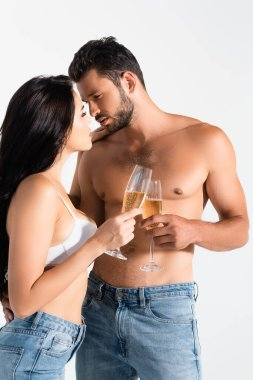 Sexy couple holding glasses of champagne isolated on grey stock vector