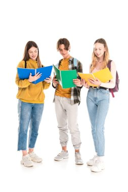 Smiling teenagers with backpacks looking at copy books on white background stock vector