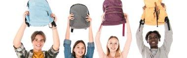 Panoramic shot of smiling multiethnic teenagers holding backpacks isolated on white stock vector