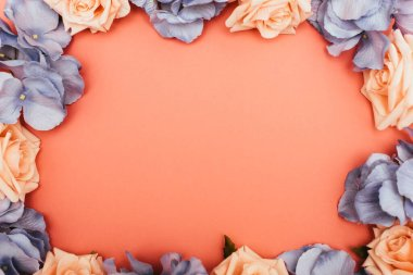 Top view of floral frame on coral background stock vector
