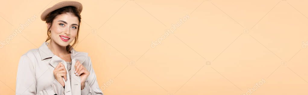 Website header of stylish woman in beret and trench coat looking at camera isolated on peach stock vector
