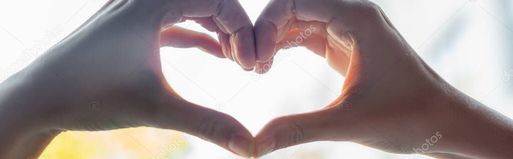 Cropped view of woman showing heart-shaped sign with hands, horizontal banner stock vector