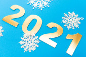 white snowflakes and 2021 numbers on blue background