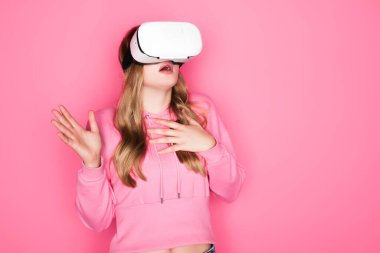 Scared beautiful woman in vr headset on pink background stock vector