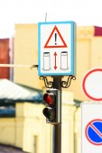 Fotografie close up view of road signs and semaphore with blurred background