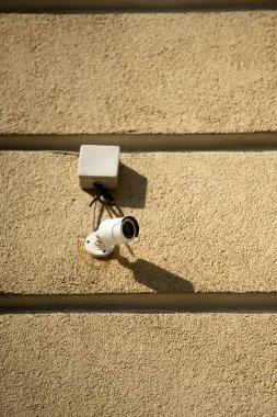 closeup shot of security camera on building facade in sunlight