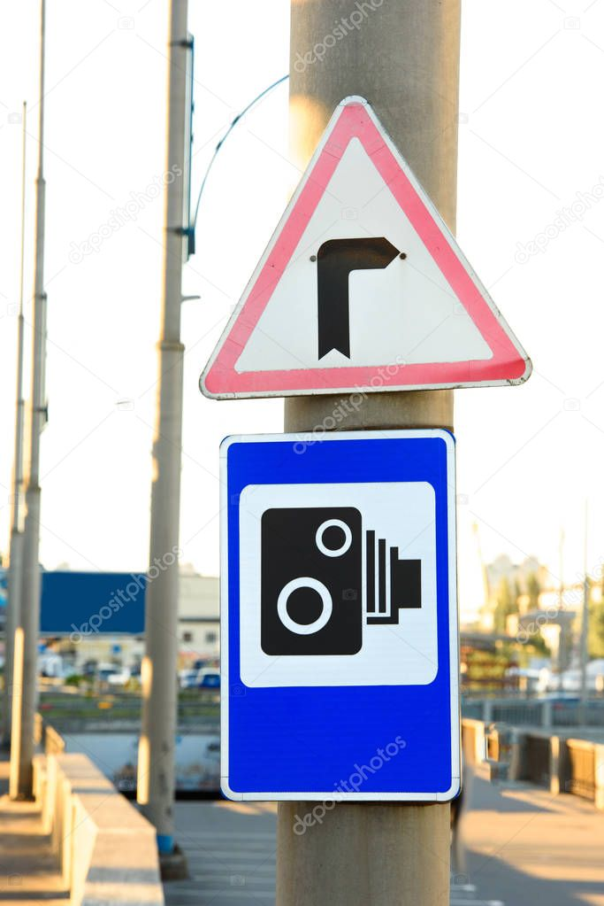 close up view of pole with traffic signal cameras and turn right signs
