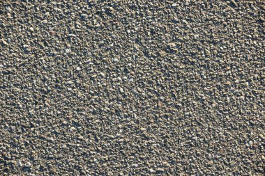 full frame image of wall with gray gravel background