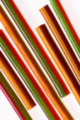 top view of colorful gummy stripes isolated on white