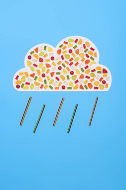 Top view of rainy cloud made of gummy candies isolated on blue stock vector