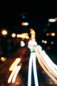 Noční město světla v bokeh styl pozadí