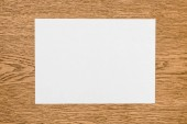 Fotografie elevated view of empty white paper on wooden table