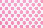 full frame image of white wall with pink dots background