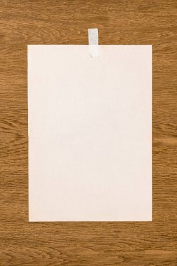 top view of blank white paper on wooden table