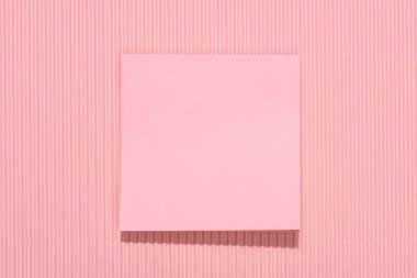 Elevated view of blank stick it note on pink stock vector