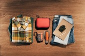 top view of travel items set on wooden table