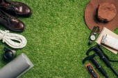 Fotografie flat lay with traveler set on green grass