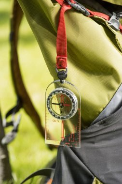 close-up view of compass hanging on backpack